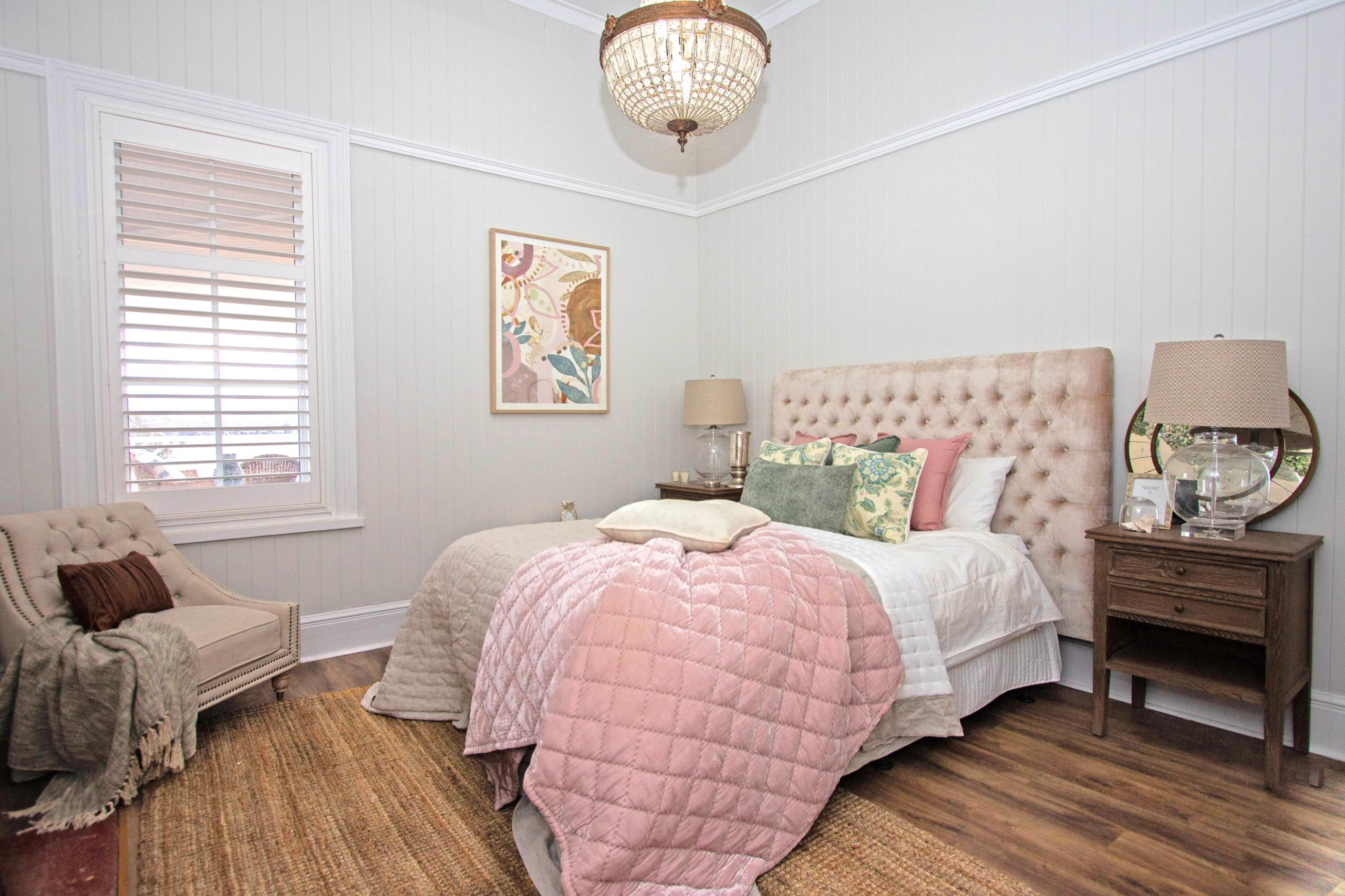 Guest bedroom with vertial groove board and picture reail